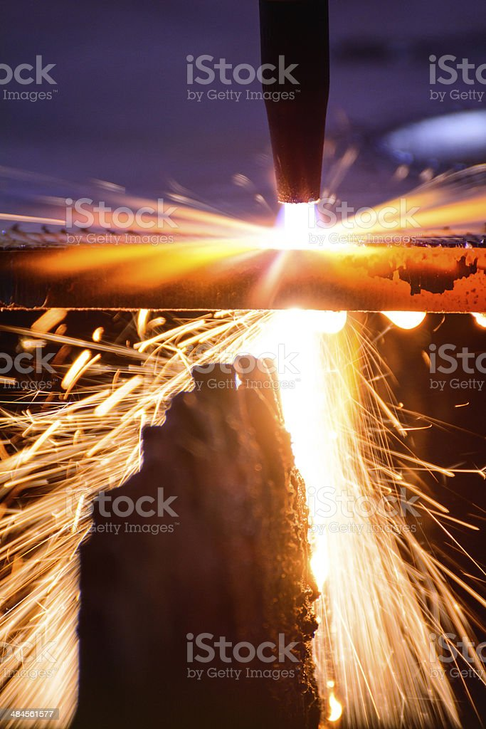 metal cutting with acetylene torch in low Light with close-up stock photo