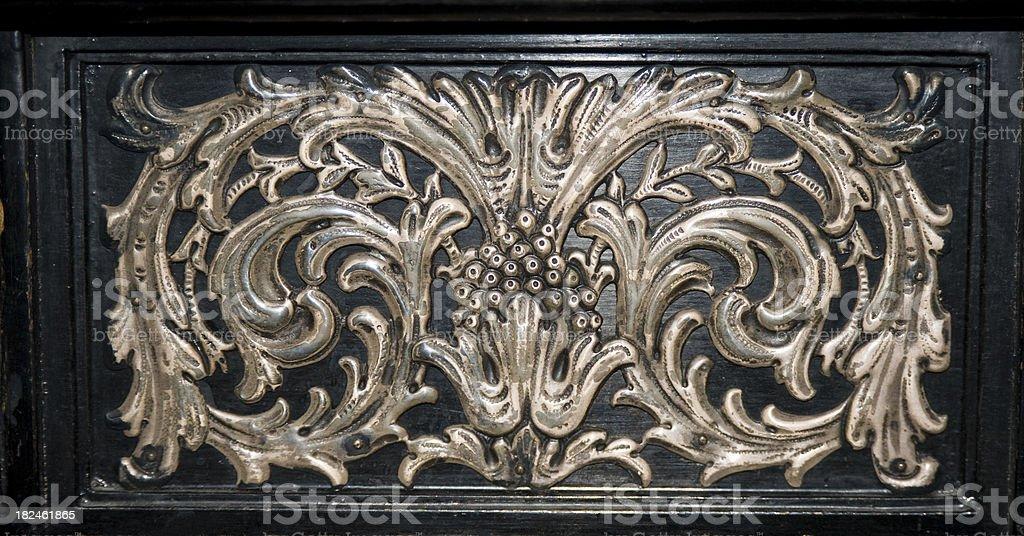 Metal Design on Antique Buffet stock photo