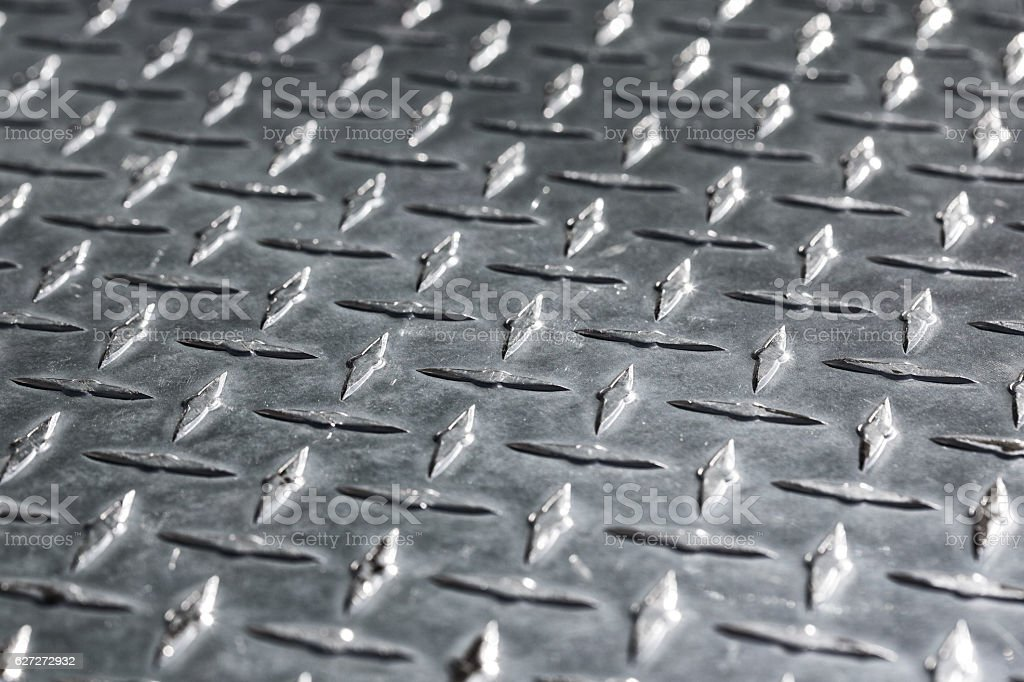 Metal diamond plate pattern and background stock photo