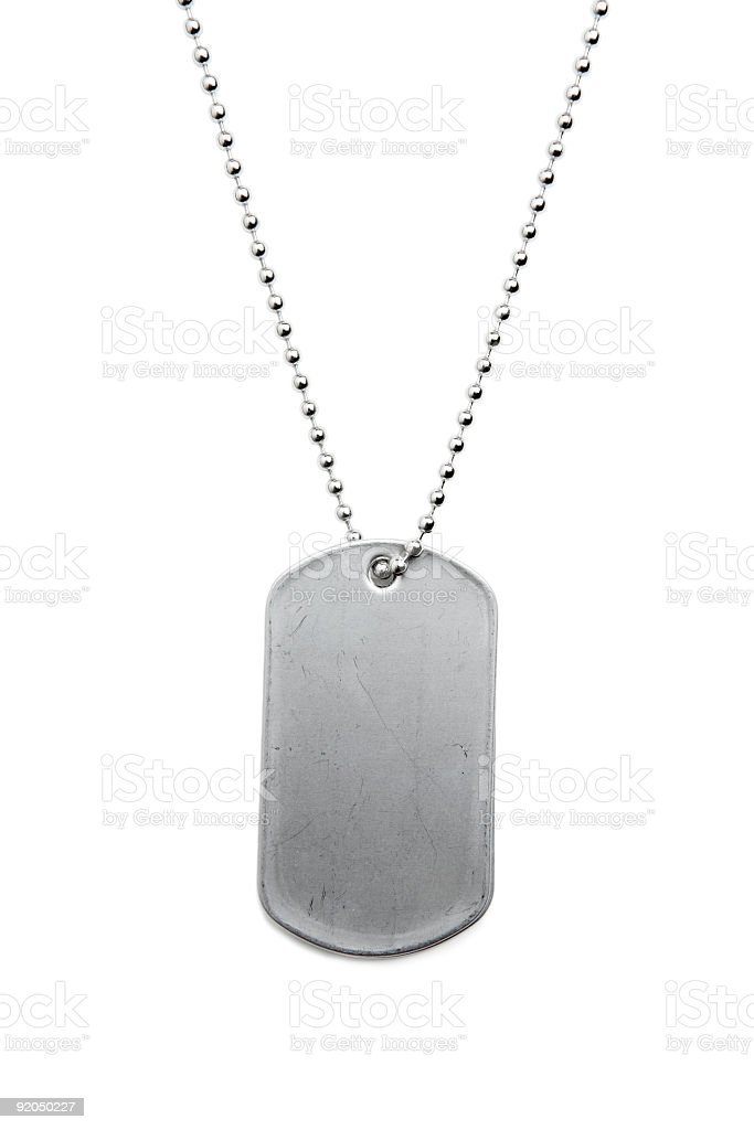 A metal dogtag on silver color royalty-free stock photo