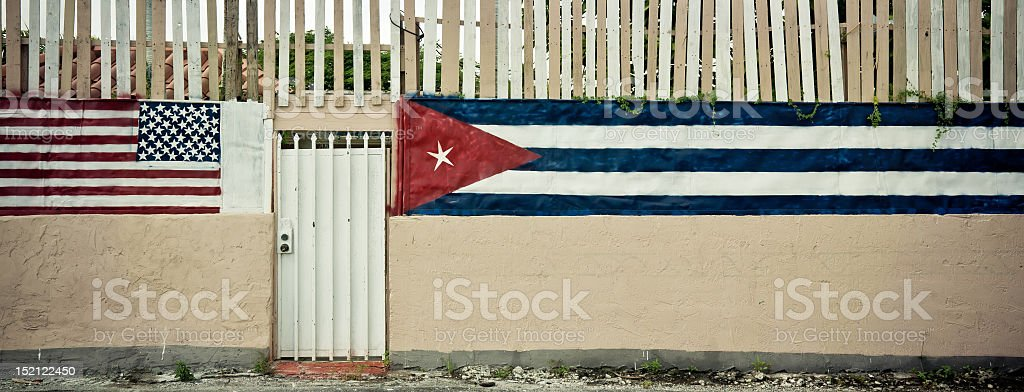 Metal door and the American and Cuban flags painted opposite stock photo