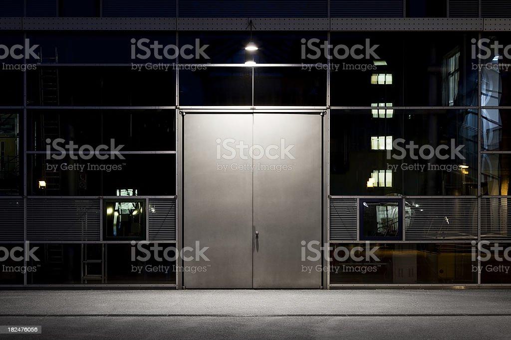 Metal door, architectural detail - night shot stock photo