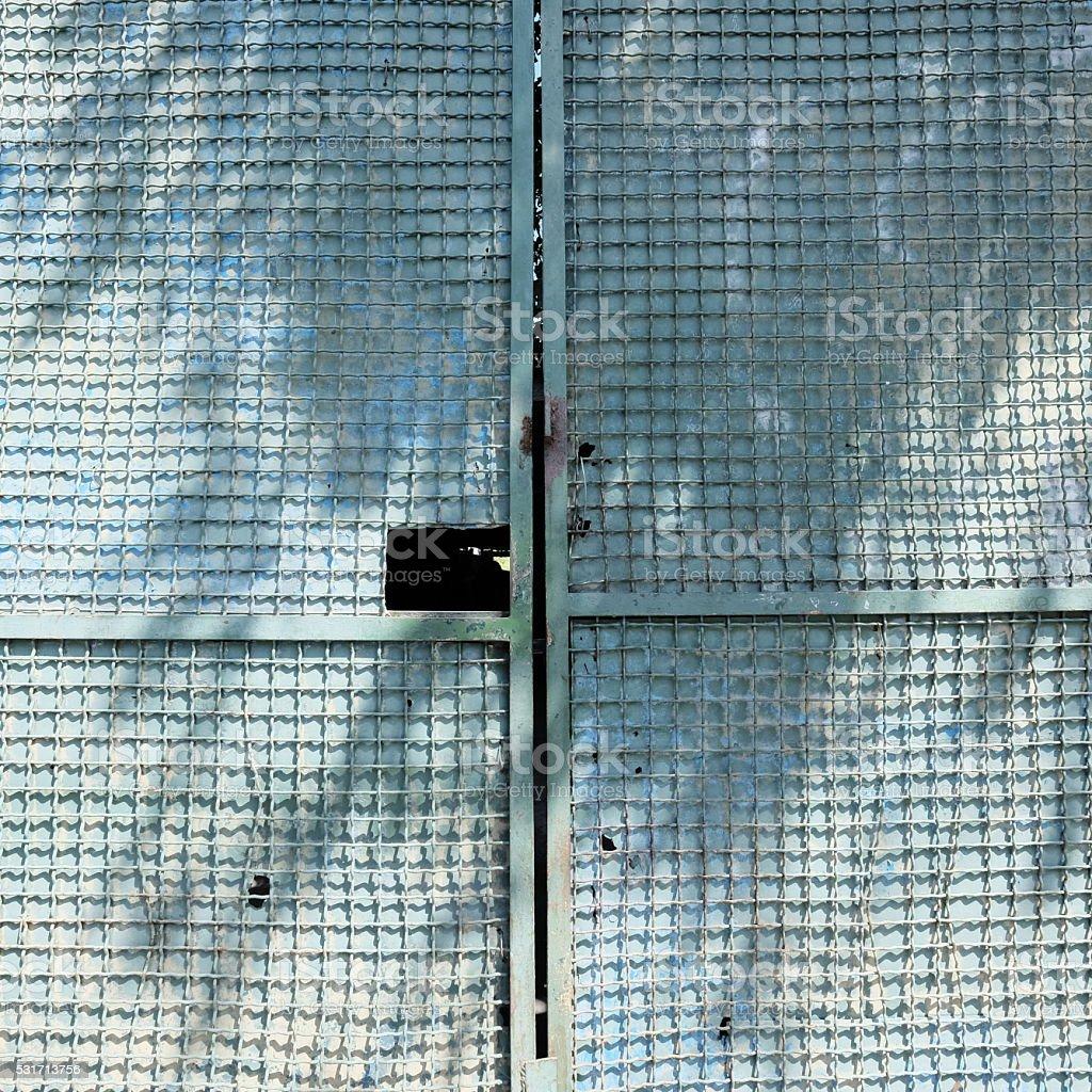 Metal door with wire mesh, textured background stock photo