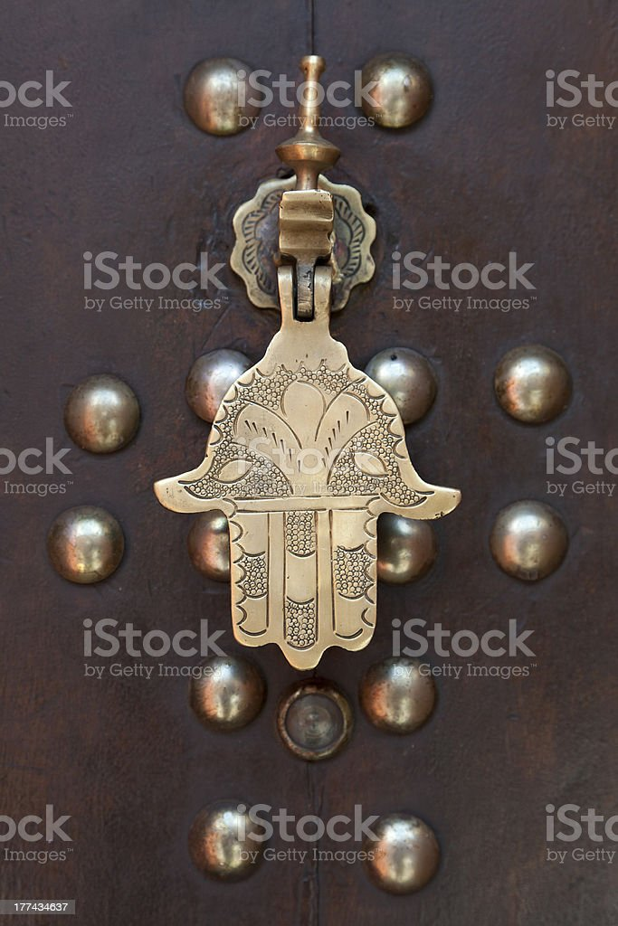 Metal doorknocker Hand of Faitima stock photo