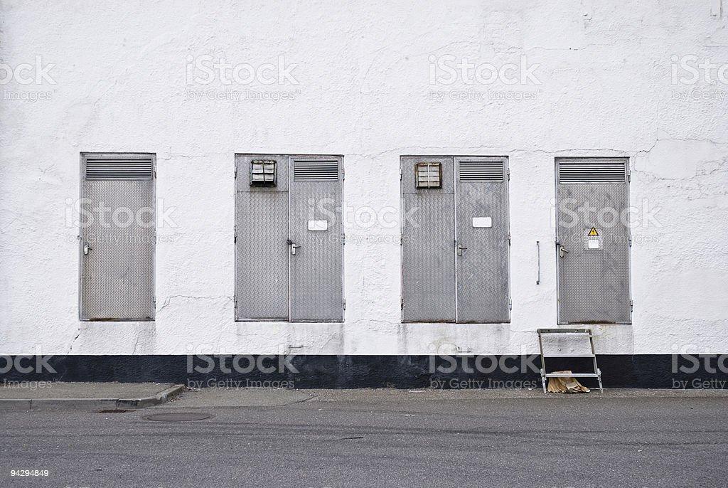Metal doors on white building stock photo