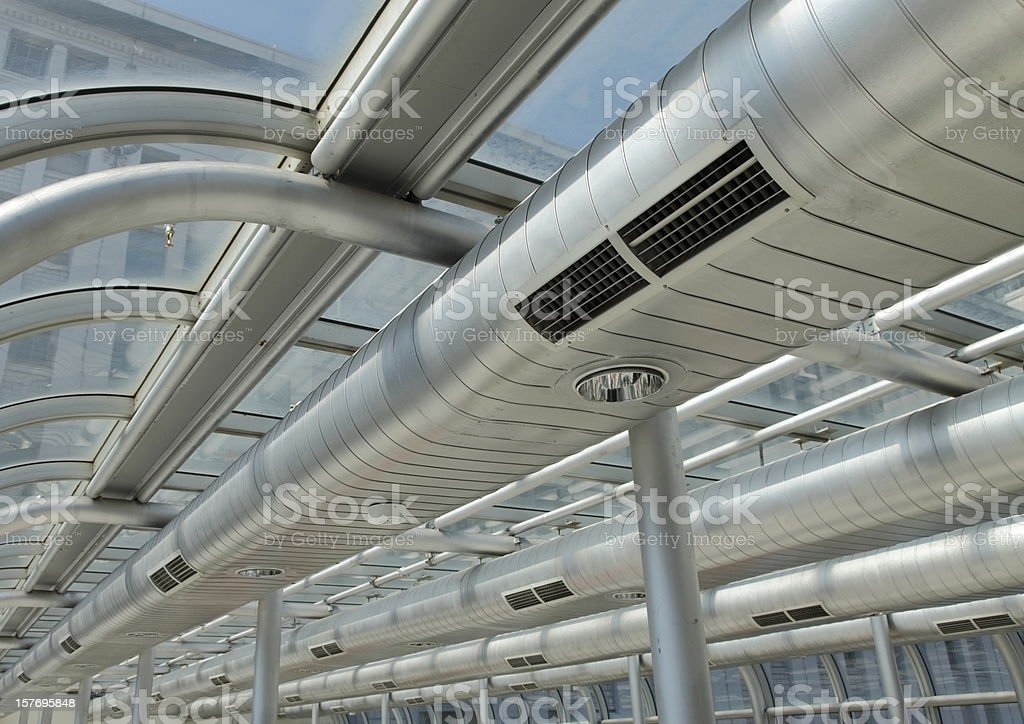 Metal ducting on the ceiling of a building  stock photo