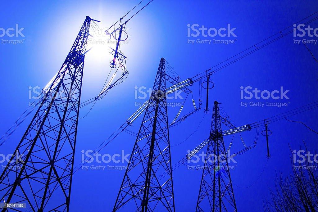metal electricity pylon  transmit  electricity  on the sky background city royalty-free stock photo