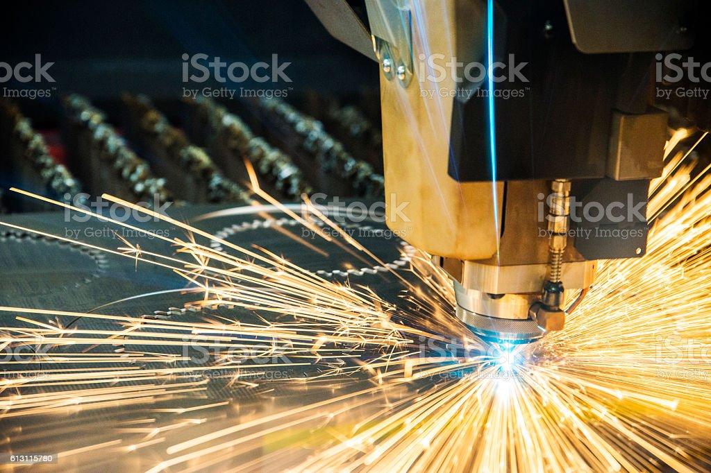 Metal fabrication. Laser cutter, cutting sheet metal. stock photo