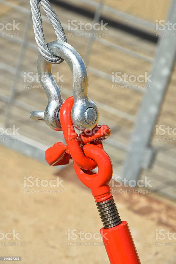 Metal fastener with steel rope stock photo