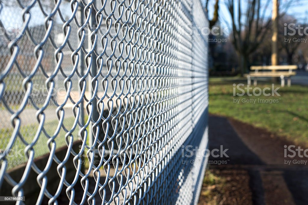 metal fence cage closeup in a park stock photo