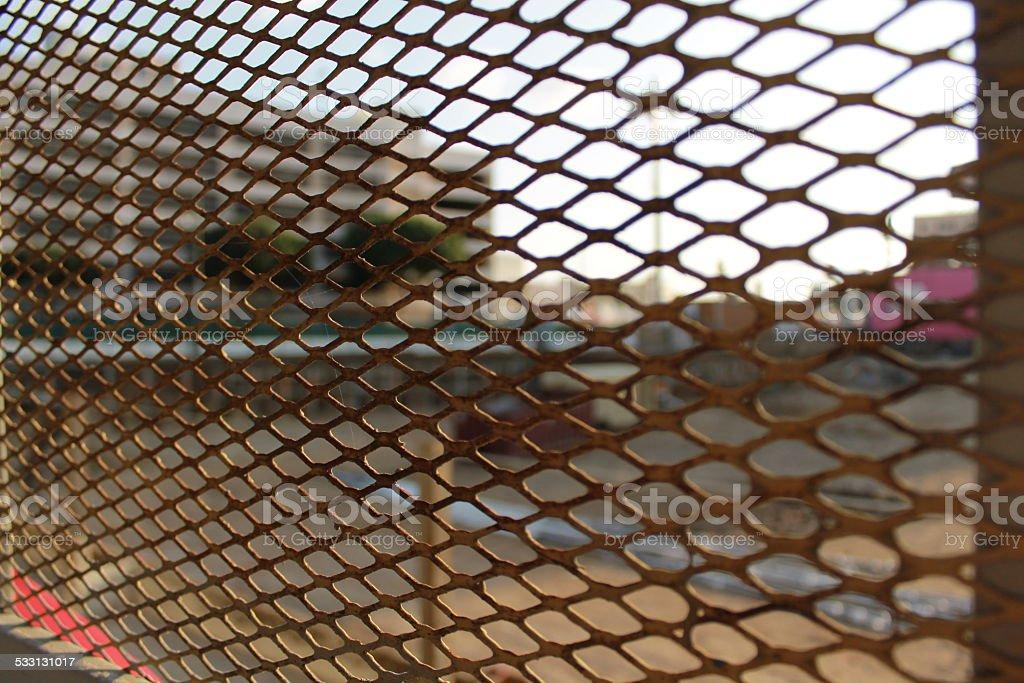 Metal Fence in Urban Setting stock photo