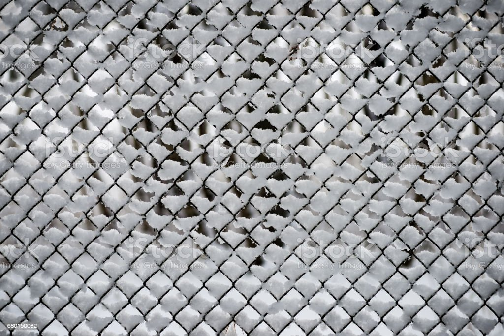 metal fence in winter stock photo