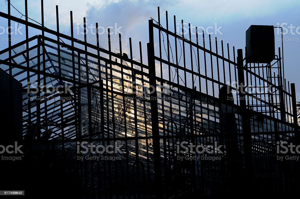 Metal fence of the greenhouse stock photo
