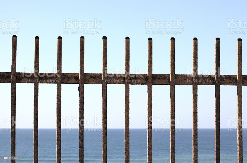 Metal fence with sea view stock photo