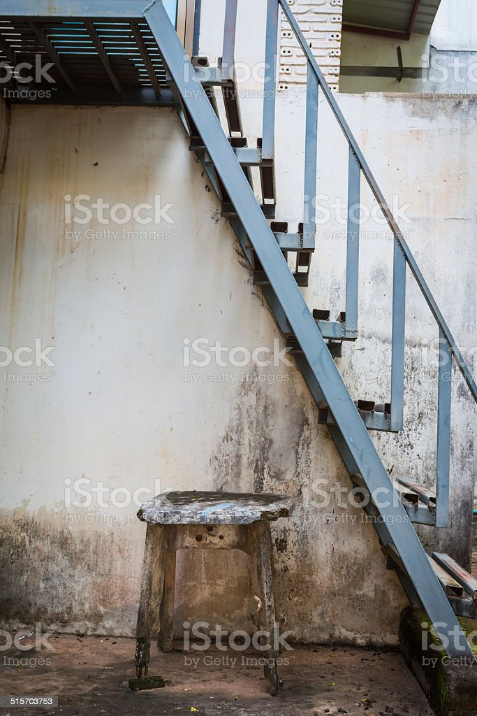 Metal fire escape old table stock photo