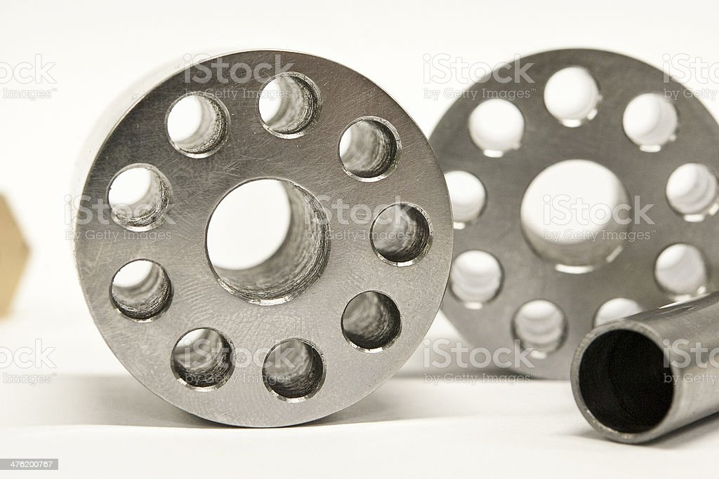 Metal flanges and cylinders.  Milling industry. Close-up. royalty-free stock photo