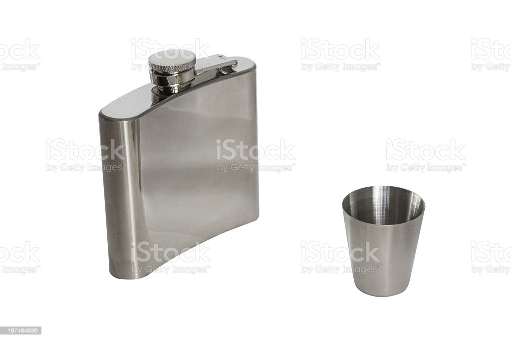 Metal flask with a stack of (Isolated) royalty-free stock photo
