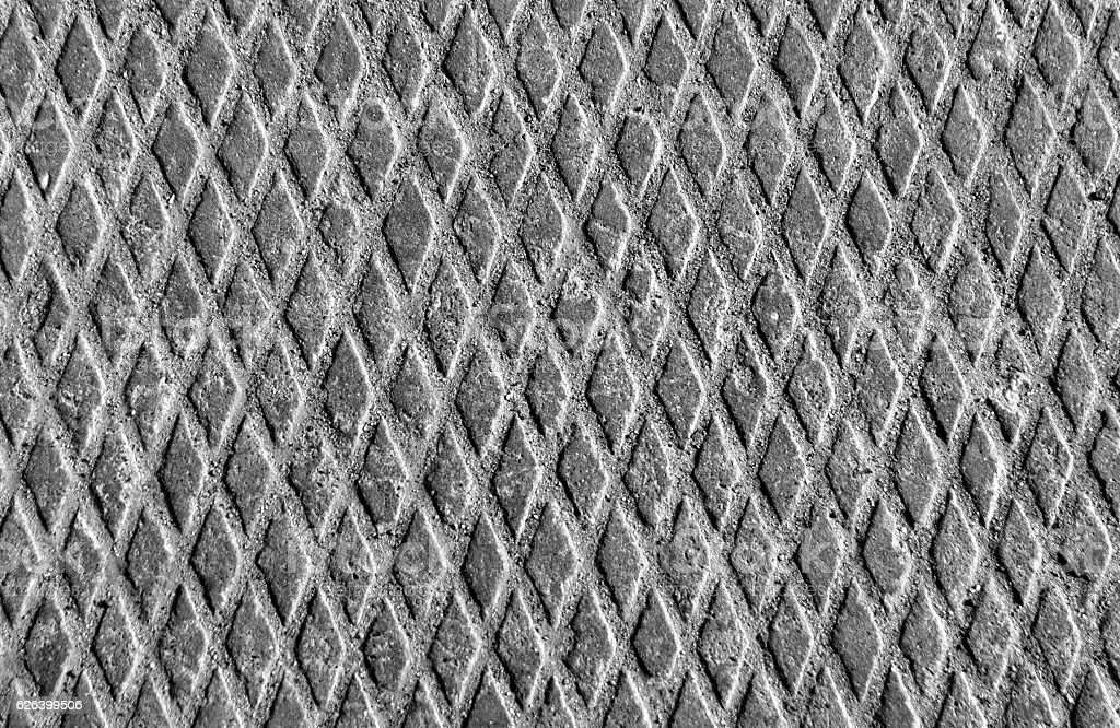 Metal floor texture with sand in black and white. stock photo