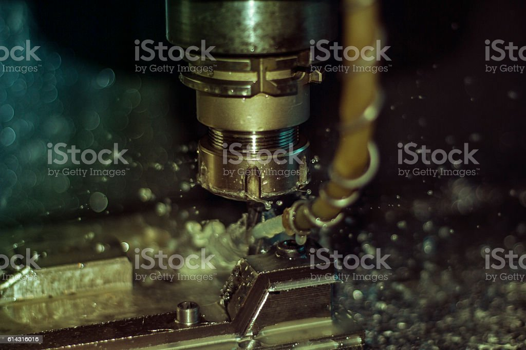 Metal forming by CNC milling machine cutting stock photo