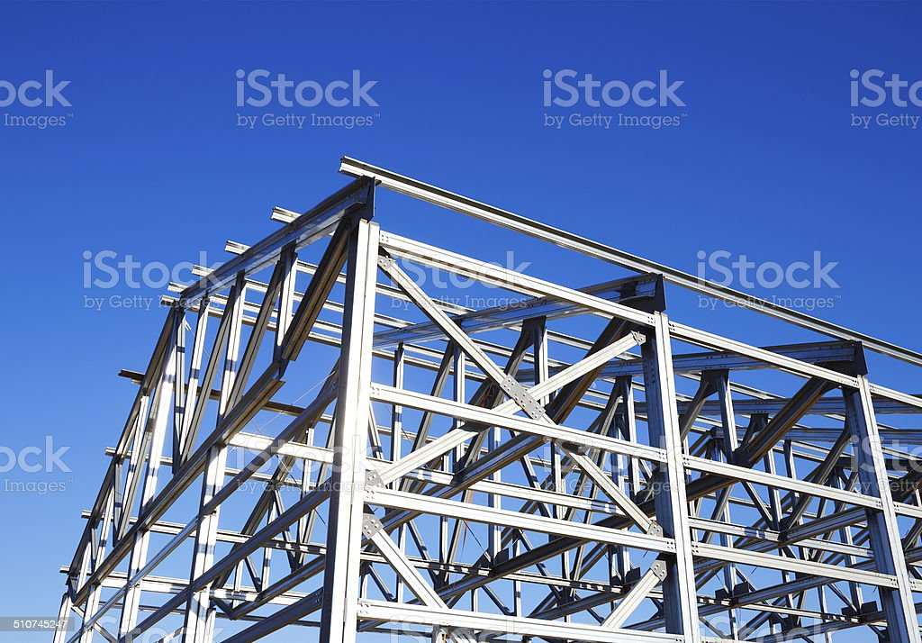 metal frame of the roof against the blue sky stock photo