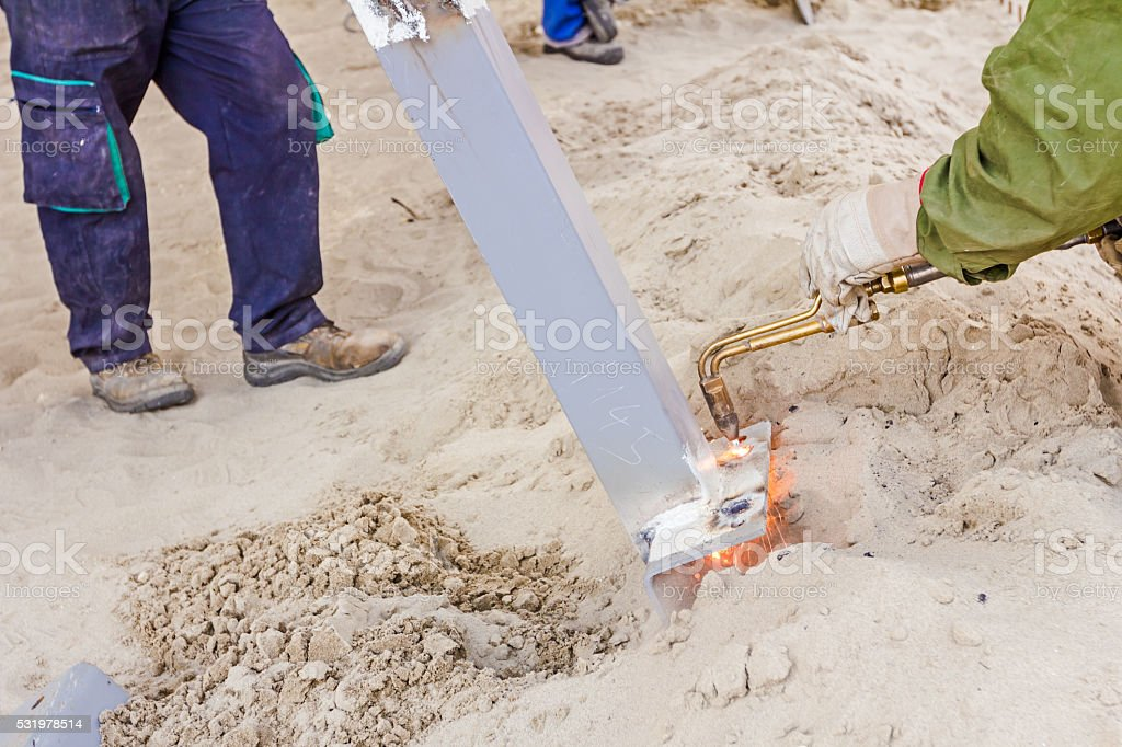 Metal gas cutting with acetylene torch, sparks flies. stock photo