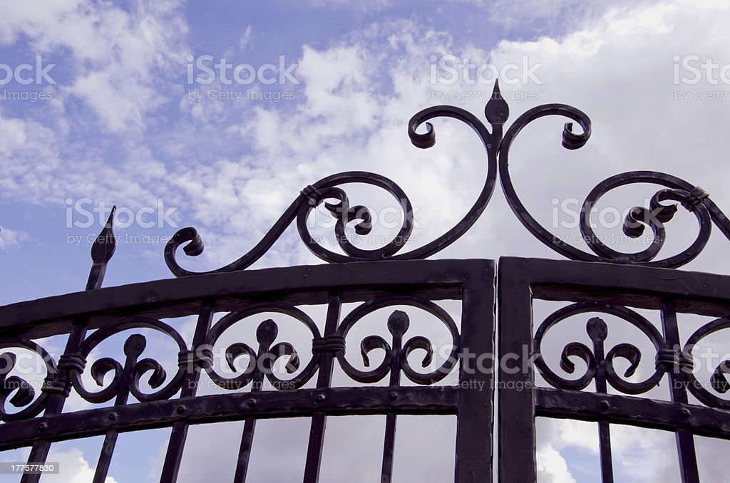 metal gate fragment and sky royalty-free stock photo