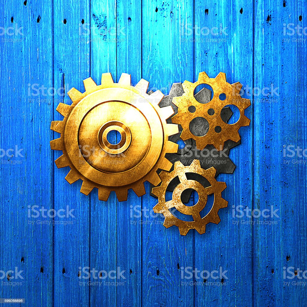metal gear on blue rustic wood board. meterial design. stock photo
