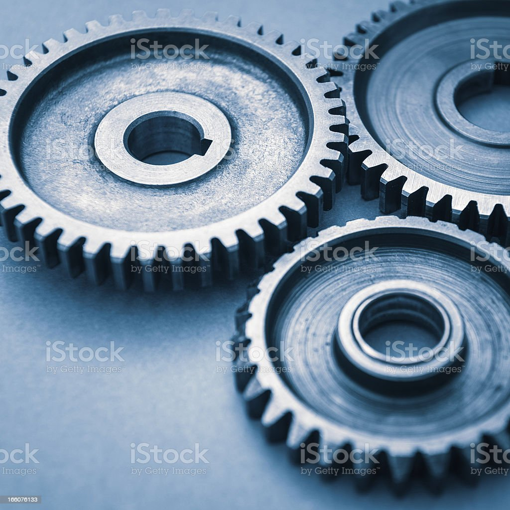 Metal Gear working like machine part royalty-free stock photo