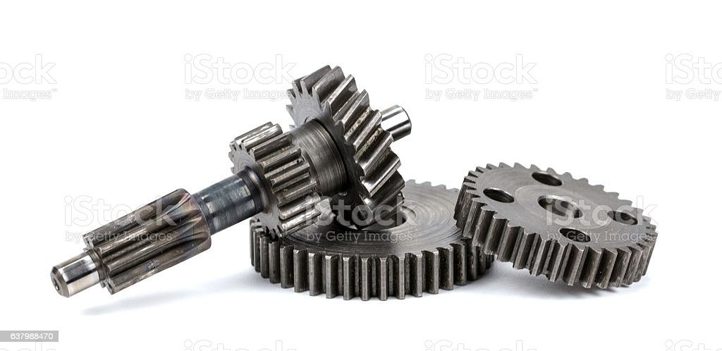 Metal gears on plain background stock photo