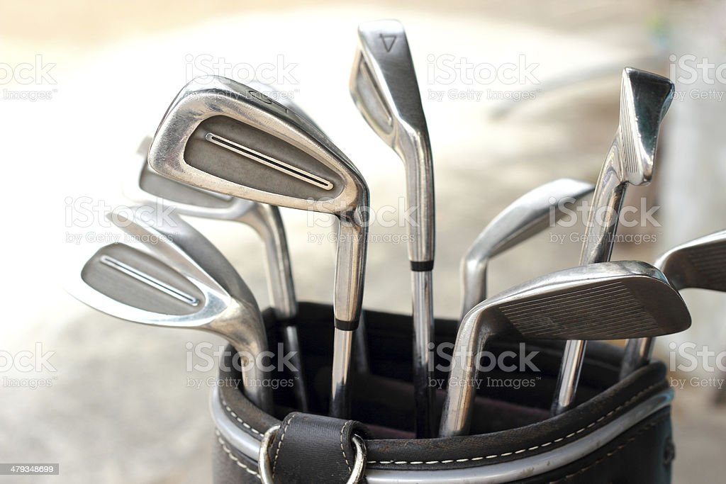 metal golf clubs in bag stock photo