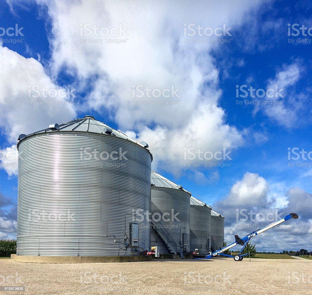 Metal Grain Bins on a farm stock photo