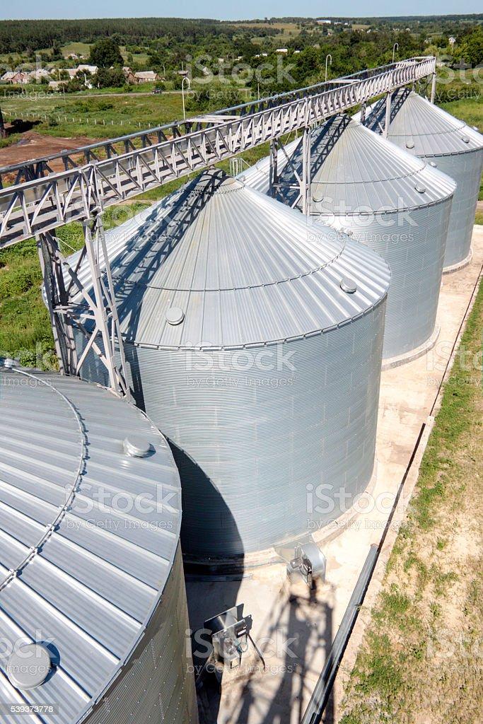 Metal grain bins stock photo