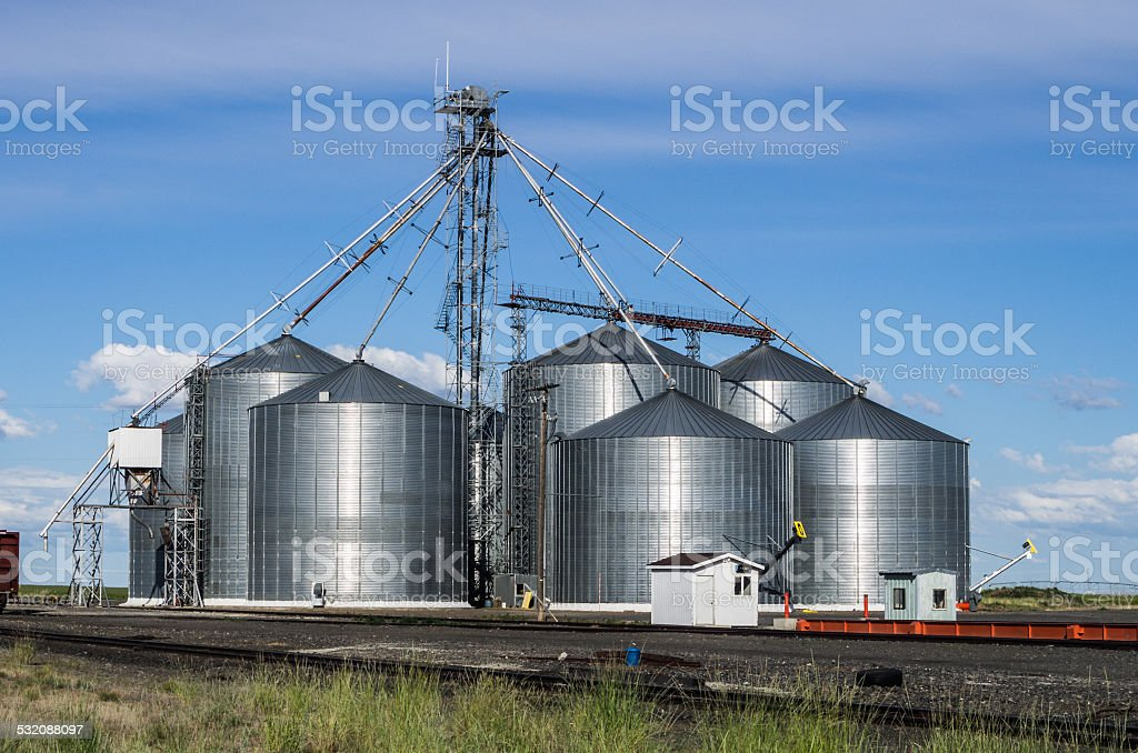 Metal grain storage silo facility stock photo