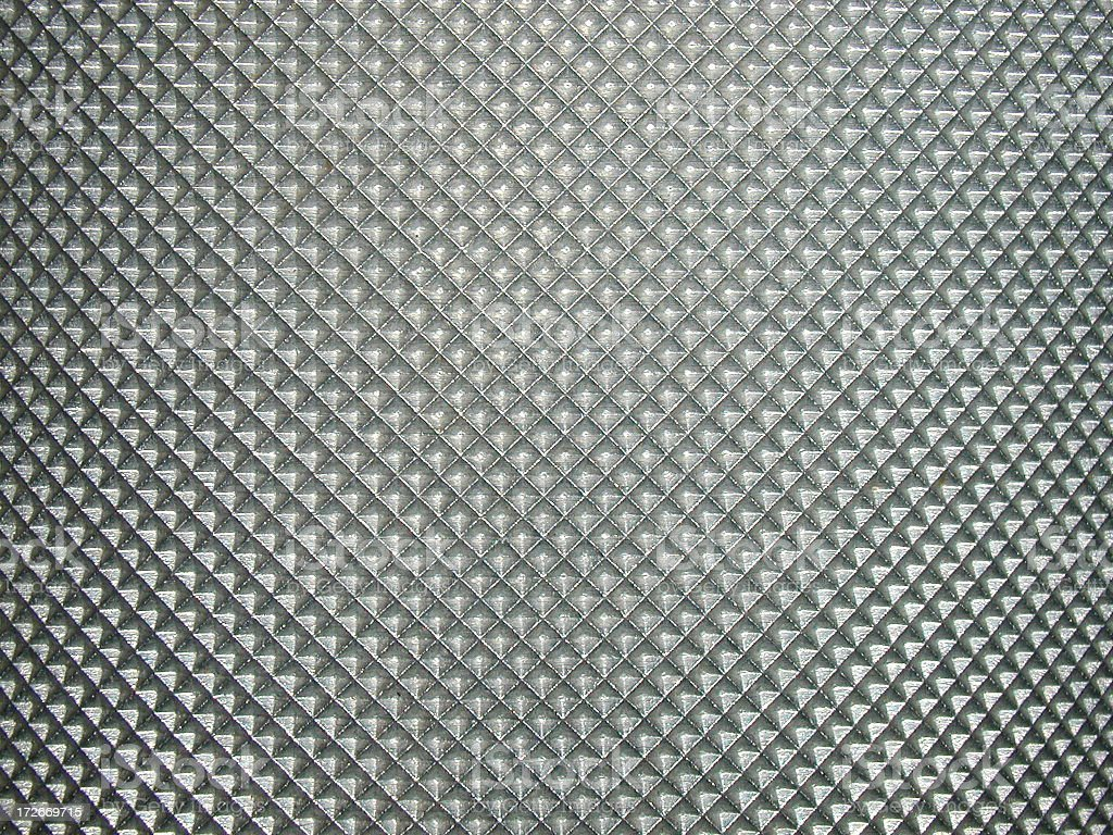 Metal grid with a diamond pattern royalty-free stock photo