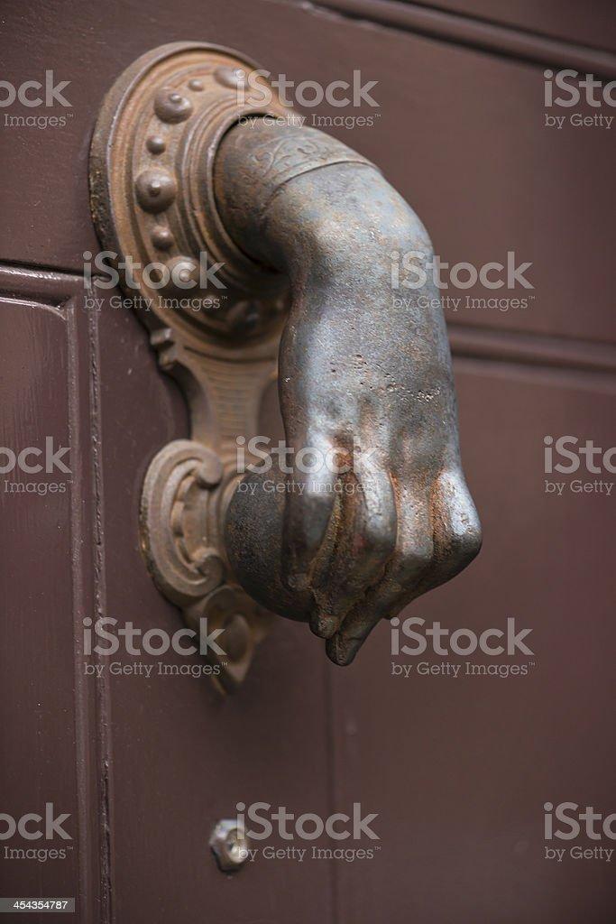 Metal hand as handle stock photo