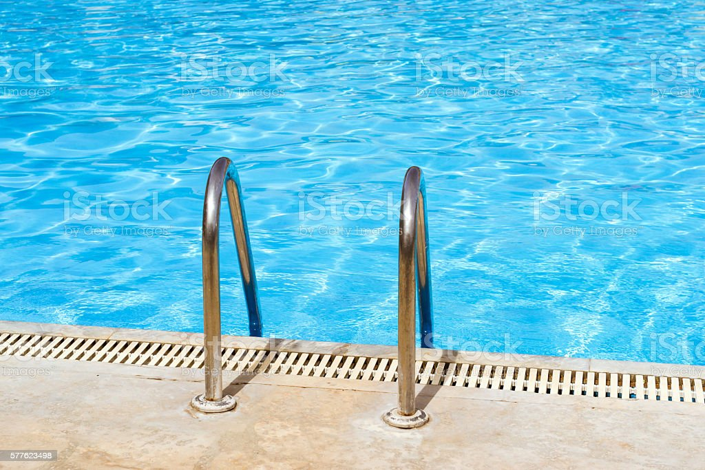 Metal hand railing of staircase to public swimming pool stock photo