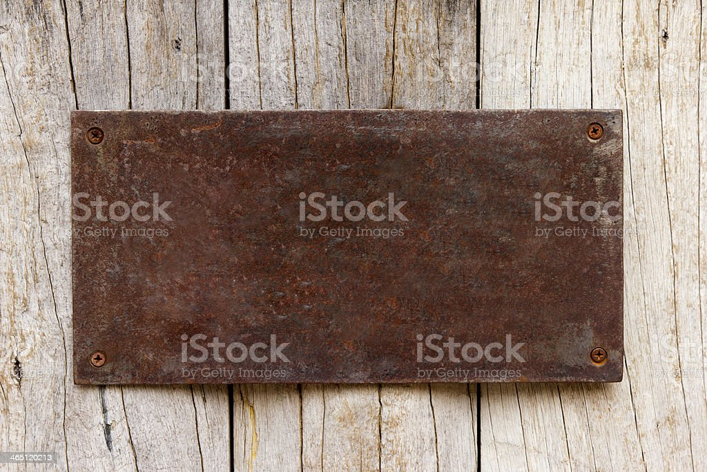 Metal have rust decorative plate on wood stock photo