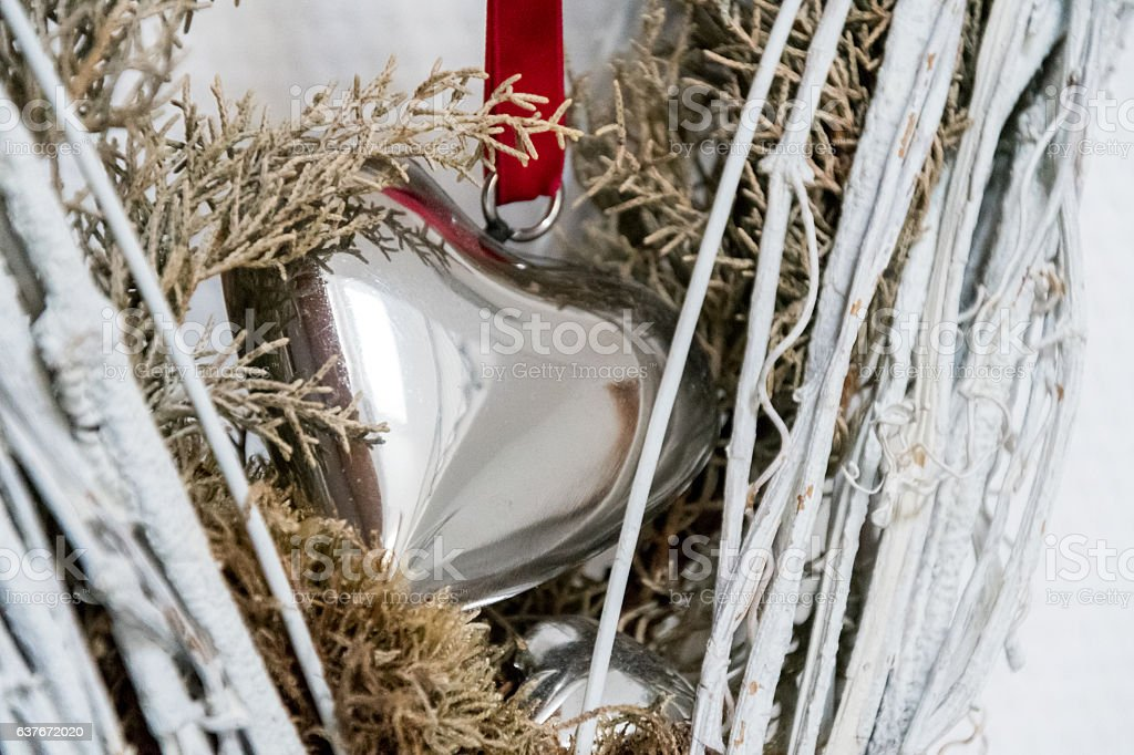Metal heart sourrounded by white and green wood stock photo