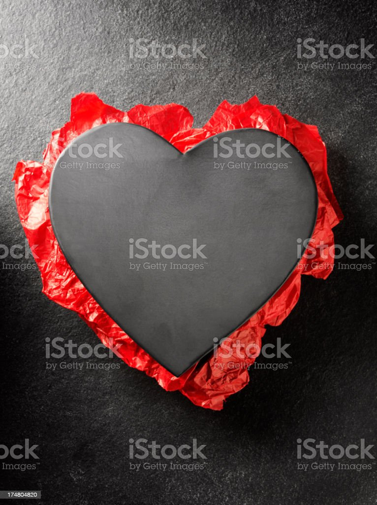 Metal Heart with Red Paper royalty-free stock photo