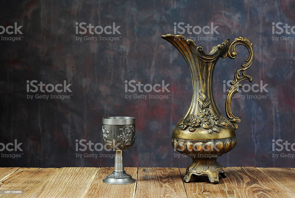 Metal jug and chalice stock photo
