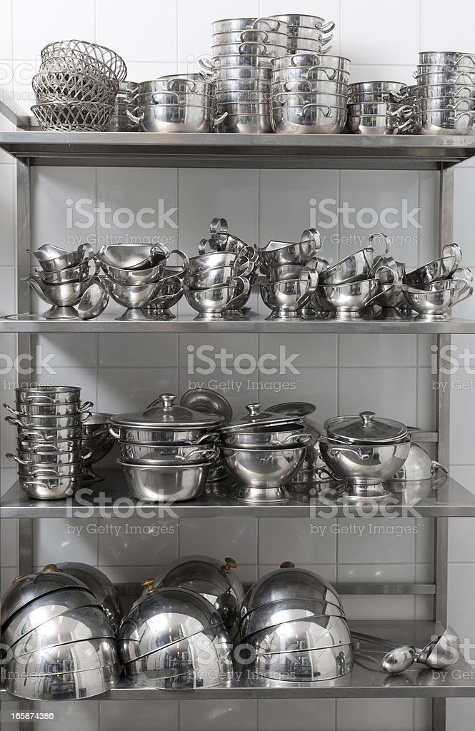 metal kitchen and serving utensils in storage room stock photo
