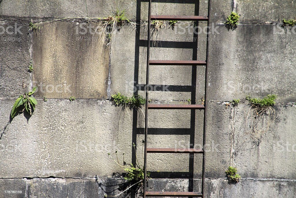 Metal ladder on a quay wall stock photo