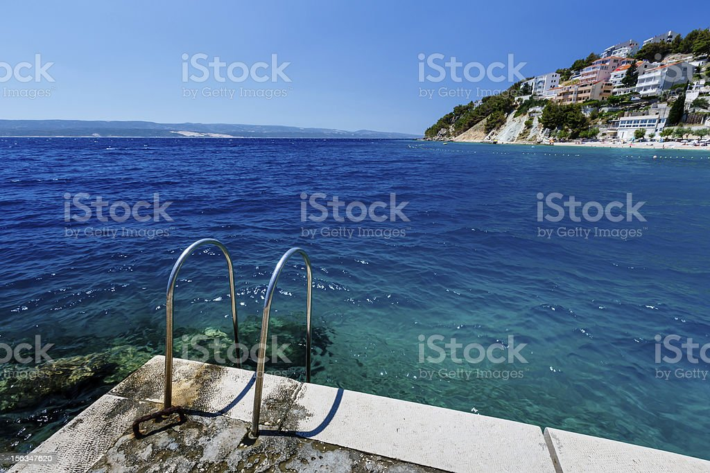 Metal Ladder on the Beach and Azure Mediterranean Sea royalty-free stock photo