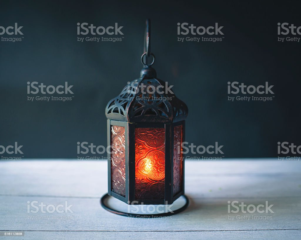 Metal lantern with space on dark background stock photo