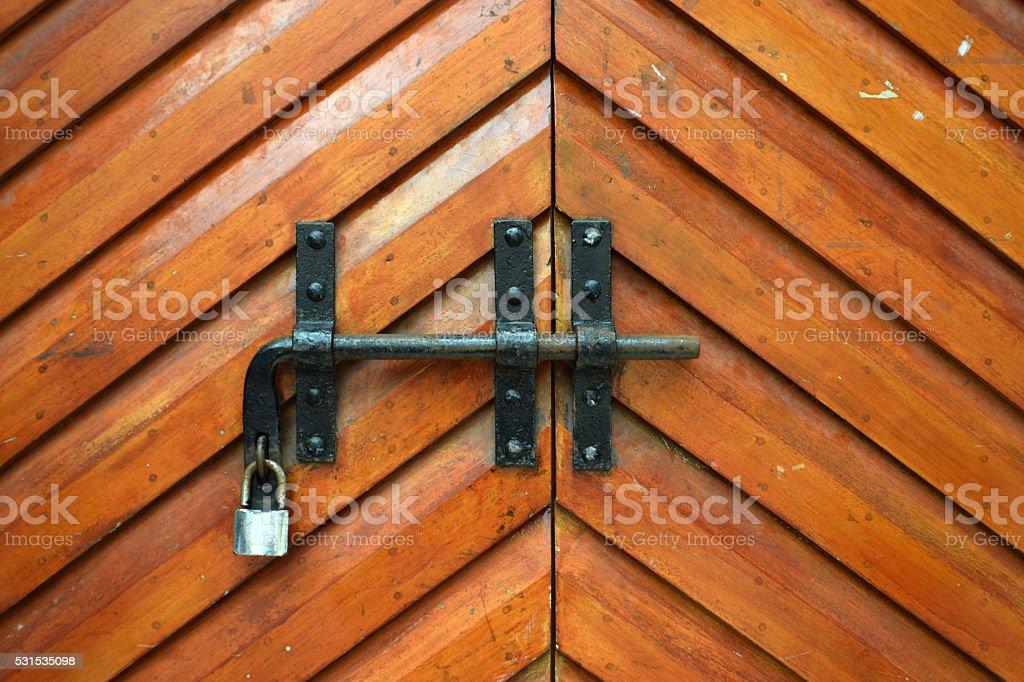 Metal latch on the wooden door stock photo