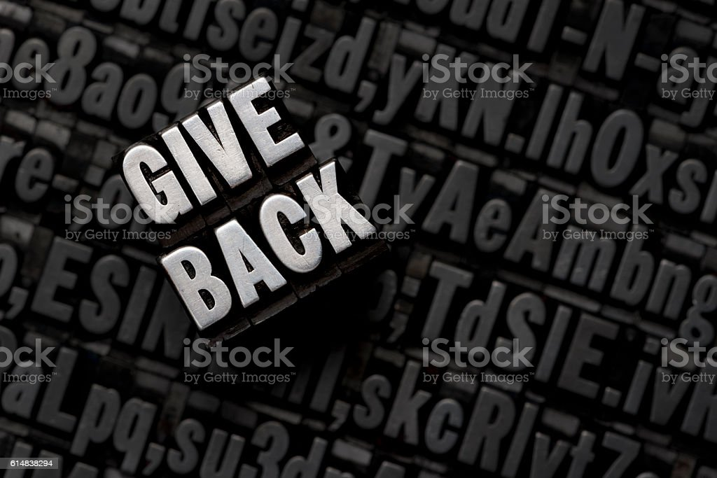 GIVE BACK - Metal letterpress type stock photo