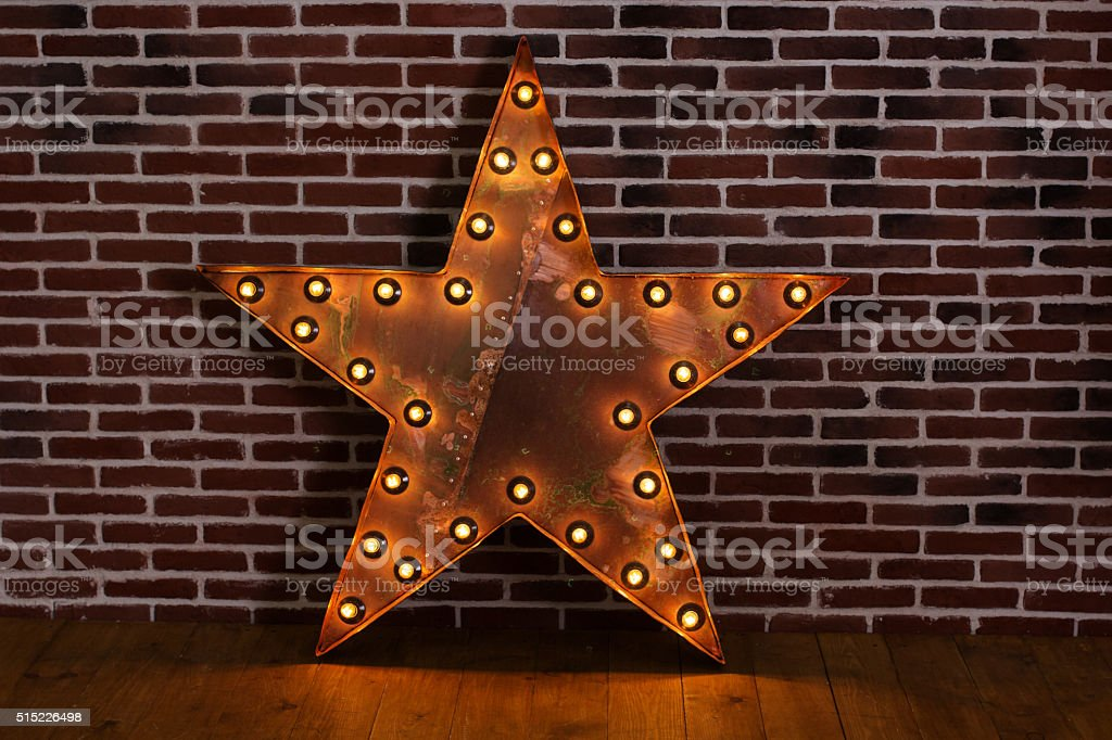 Metal lighting five-pointed star with lamps stock photo