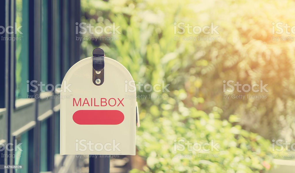 Metal Mailbox in with vintage filter stock photo