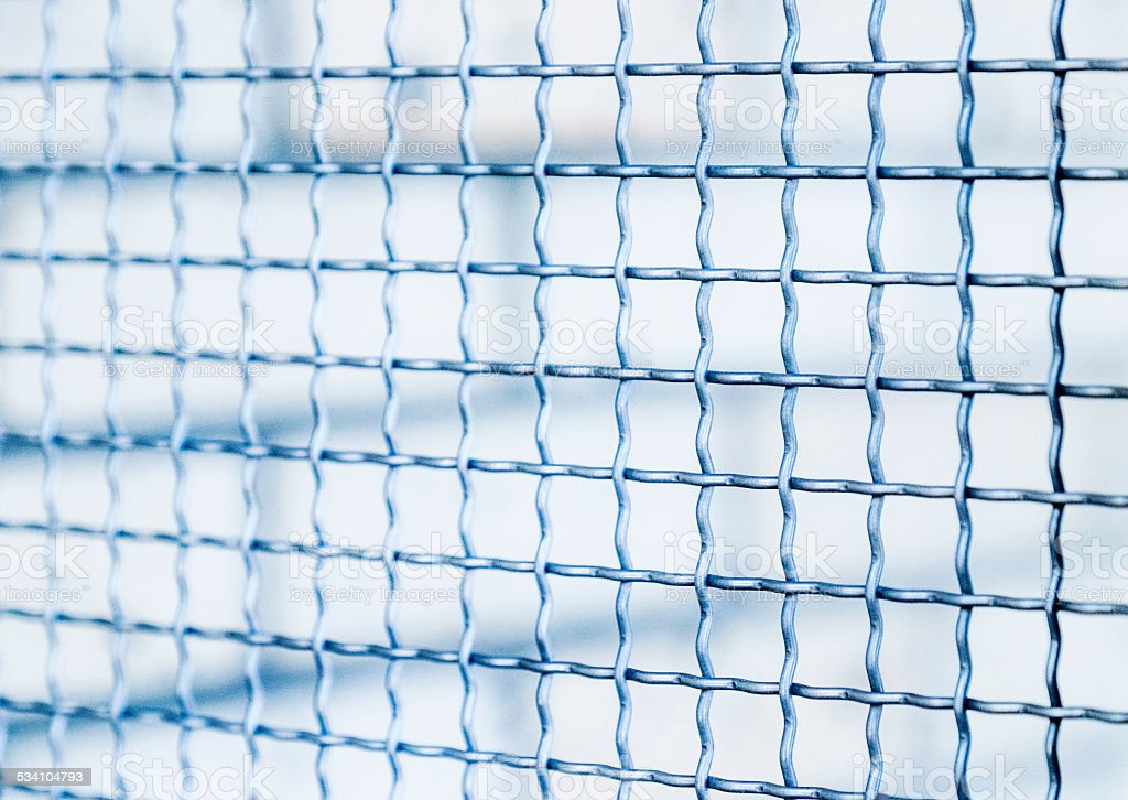 Metal mesh fence background stock photo