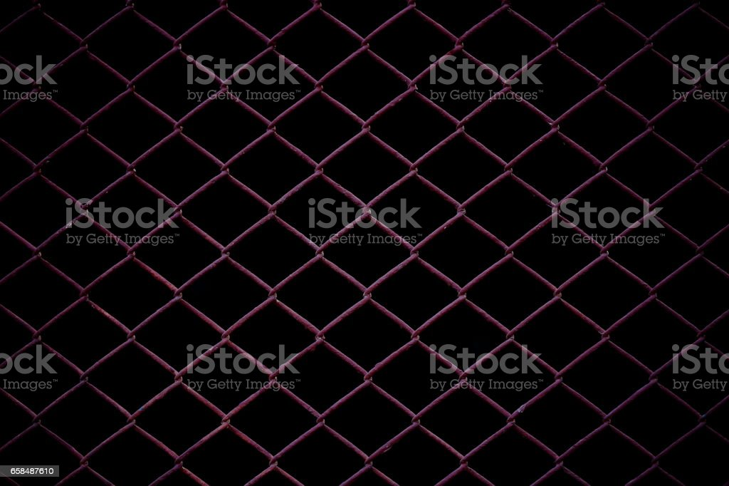Metal Mesh Fence isolated on black background. stock photo